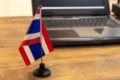 泰国的旗子有旗杆和笔记本的 库存图片