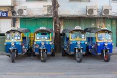泰国的Tuk Tuk出租汽车服务汽车原始的标志 库存图片