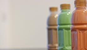 泰国茶、绿茶和咖啡在瓶 免版税库存图片