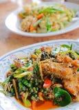 泰国辣油煎的鱼 库存照片