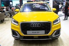 泰国- 2018年12月:在马达商展提出的奥迪Q2黄色颜色豪华昂贵的汽车暖武里泰国 库存照片