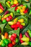 泰国Massapa ` ES,神色Choup,在香蕉的五颜六色的可删除的仿制果子留下容器 库存照片