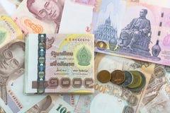 泰铢钞票硬币 库存图片