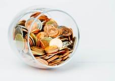 泰铢铸造在玻璃瓶的金钱 免版税库存照片
