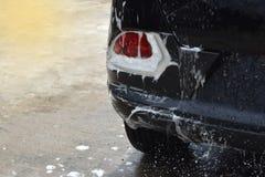 洗涤尾巴光汽车黑色,泡影填装了区域和空的空间文本的 库存图片