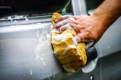 洗涤有肥皂的汽车 免版税库存图片