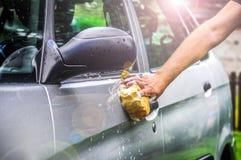 洗涤有肥皂的汽车 免版税图库摄影