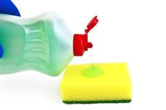 洗碗盘行为胶凝体海绵 免版税库存照片