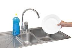 洗碗盘行为 免版税库存照片