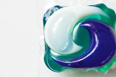 洗衣店的洗涤的胶囊在白色背景 免版税库存照片