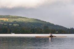 洛蒙德湖的划船者日出的 免版税图库摄影