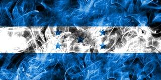 洪都拉斯在黑背景隔绝的烟旗子 免版税图库摄影