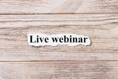 活webinar在纸的词 概念 词的活webinar在木背景 图库摄影