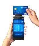 流动付款概念,拿着有处理的手智能手机流动付款 免版税库存图片
