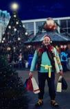 流浪汉高兴在圣诞节销售 库存图片
