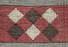 流浪的传统羊毛地毯纹理有几何啪答声的 库存照片