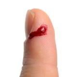 流血从被剪切的手指 免版税库存图片
