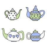 浅兰和桃红色上色,套四个逗人喜爱的茶壶 免版税库存照片