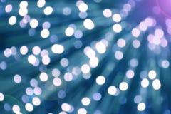 浅兰的天空颜色Bokeh与火光和迷离移动的 免版税库存图片