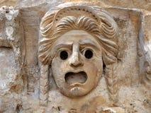 浅浮雕-石头面具  免版税图库摄影