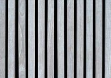 浅灰色的木板条背景,绘与不伤环境的颜色,被排行的垂直 免版税库存图片