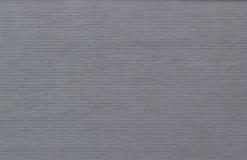 浅灰色的被绘的砖墙 库存照片