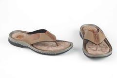 浅褐色的皮革凉鞋 免版税库存照片