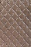 浅褐色的缝制的皮革背景 免版税库存照片