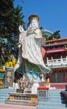 """浅水湾,香港†""""2016年3月02日:观音工业区雕象位于寺庙在击退海湾海滩香港结束时 库存照片"""