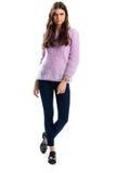 浅紫色的毛线衣的妇女 库存照片