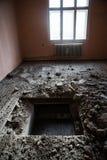 测试孔在老房子 免版税图库摄影