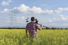 测量员油菜籽测量学工程师 免版税库存照片