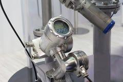 测量流程的榫眼超音波流量计液体和温度传感器 免版税图库摄影