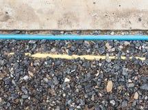 测量深度和导线的PVC管子 库存图片