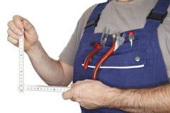 测量的工具和工作员 免版税库存图片