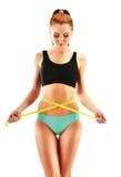 测量的性感的少妇 查出的损失评定躯干重量白人妇女 免版税库存照片