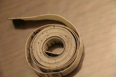 测量的磁带数字小条褐色白色背景滚动 库存照片