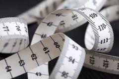 测量的裁缝磁带 特写镜头,宏指令 库存图片