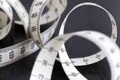 测量的裁缝磁带 特写镜头,宏指令 图库摄影