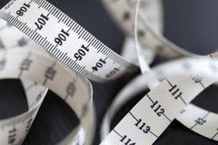 测量的裁缝磁带 特写镜头,宏指令 库存照片
