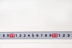 测量的长度的米在白色背景 免版税库存照片