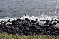 济州海岛黑色海岸线 库存照片