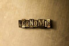 经济-脏的葡萄酒特写镜头排版了在金属背景的词 免版税库存图片