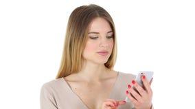 浏览在智能手机,白色背景的妇女 股票视频