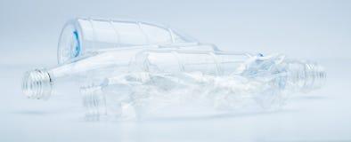 浪费在白色背景的透明塑料瓶 免版税库存照片