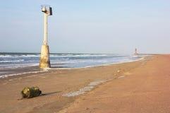 浮体和灯塔在距离 免版税库存图片