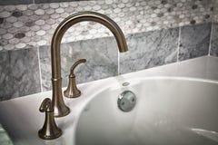 浴缸水龙头 库存图片