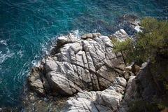 海、太阳和岩石 库存图片