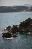 海、太阳和岩石 图库摄影