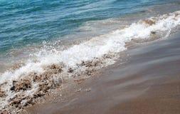 海、沙子和波浪 免版税库存照片